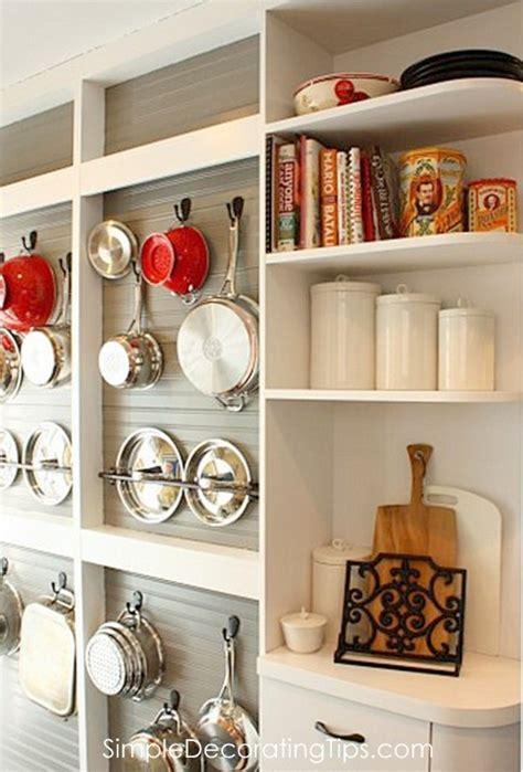 remodelaholic diy wall mounted pot rack   shallow display cabinet