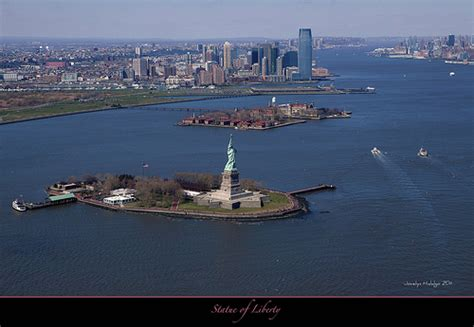 Aerial View Of Statue Of Liberty And Ellis Island