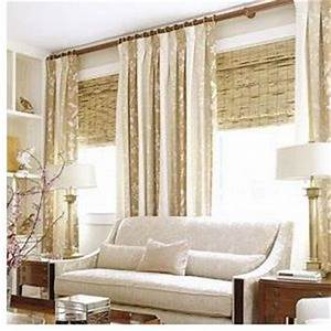 large windows dressed with heavy khaki and cream striped With bamboo curtains in living rooms