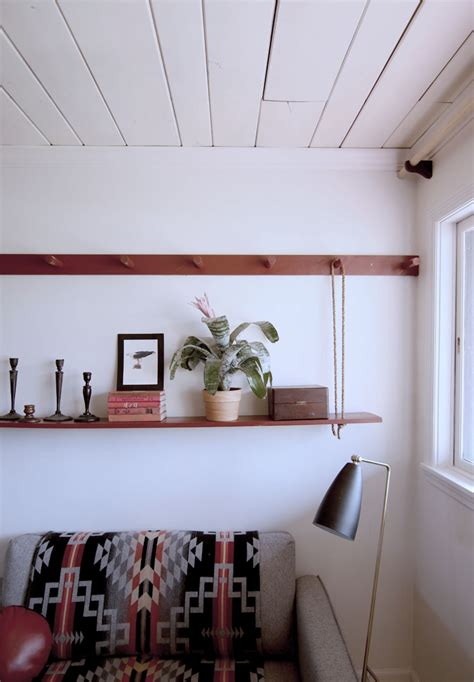 diy peg rail create  killer small space seating area