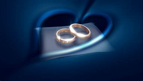 gold rings  blue cushion stock footage video