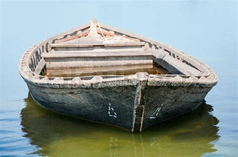 fishing boat floating   water stock photo