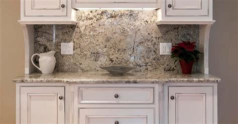 custom built kitchen  pridecraft cherry cabinets painted white   pewter glaze  sand