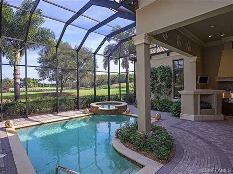 pool  outdoor fireplace grey oaks  naples fl