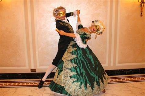 masquerade dancers ball themed stilt showgirls greet adorned walkers jesters acrobatic arrival guests pose meet