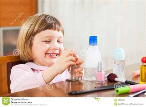 little girls makeup table little playing with makeup stock photo image of