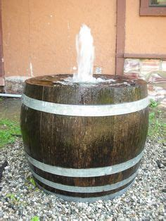 wishing  tops wine barrel planter fish pond  garden