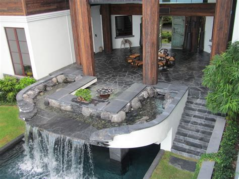 backyard patios and pool waterfall water feature and