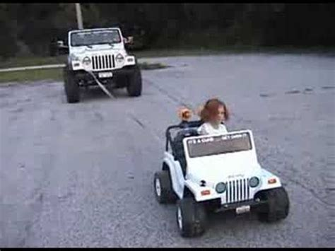extreme power wheels jeep pulling real jeep  youtube