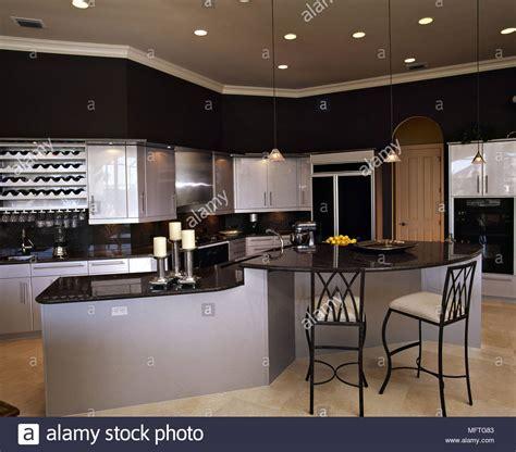 Modern kitchen grey units black granite worktops central