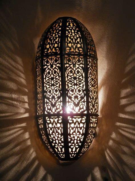 moroccan darken metal wall light sconce and its openwork