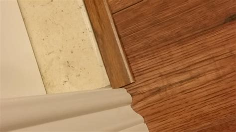 laminate flooring nearby laminate floor large gap near sliding door gaps baseboard won t cover doityourself com