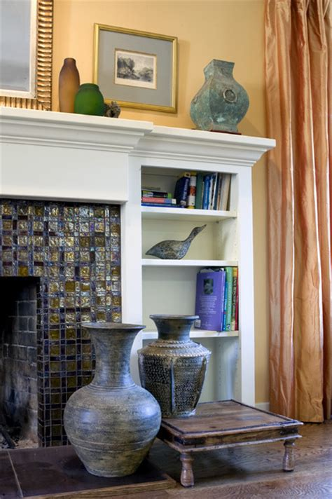 fireplace with glass tile and custom wood mantel