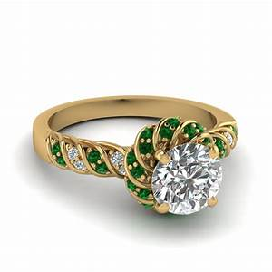 Emerald twisted halo round cut diamond ring in 14k yellow for Emerald and diamond wedding ring