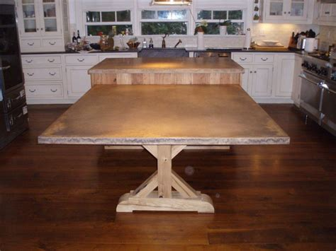 wood base stained concrete penninsula with wood farmhouse table base
