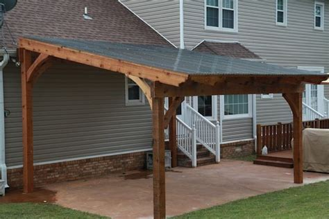 free standing pergola with polycarbonate roof panels to