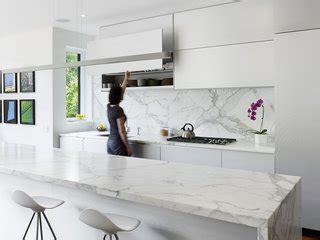 modern kitchen white cabinets marble backsplashes