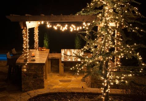 unique patio design with nice kitchen and sparkling outdoor hanging lights using wooden pergola
