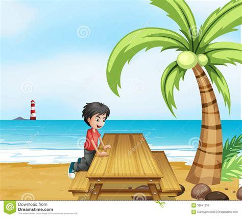 boy   beach   wooden table   coconut