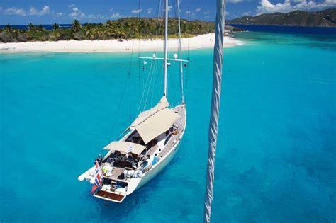 swan 66 sailing yacht godot enjoying the day off sandy