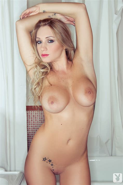 Staggering Blonde Shows Off Her Big Tits And Shaved Pussy