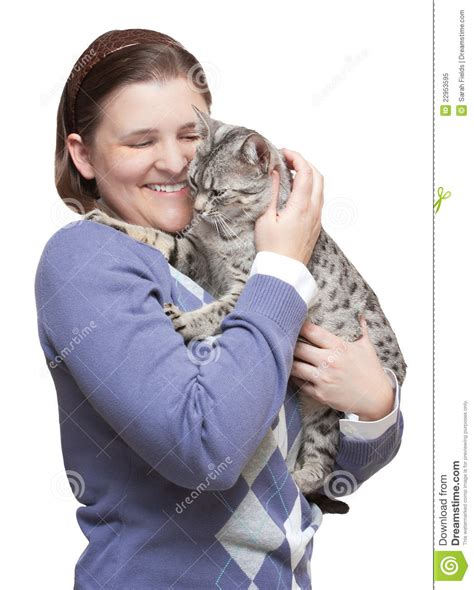 smiling woman holding happy cat royalty  stock photo