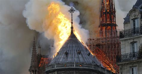 notre dame cathedral  paris  engulfed  flames