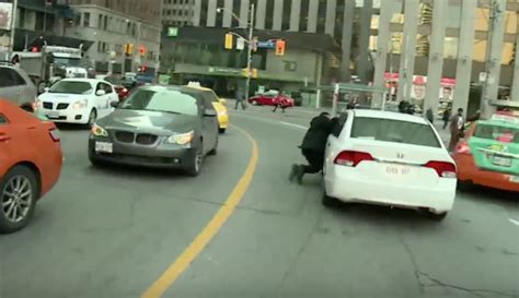 Taxi Driver Attacks Car, Dragged In Uberx Protest In