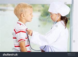 Children Playing Doctor Patient Side View Stock Photo ...
