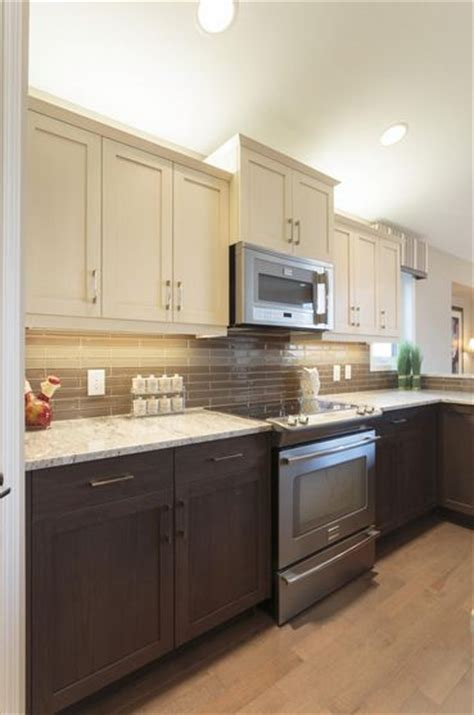 two tone painted kitchen cabinets rev your kitchen with these gorgeous two tone kitchen 8616