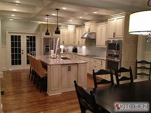 Gorgeous white kitchen with ceiling beams and