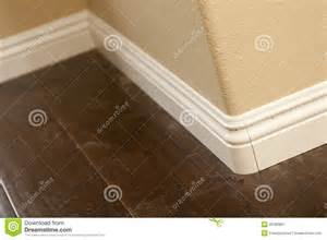 baseboard and bull nose corners with laminate flooring royalty free stock photography
