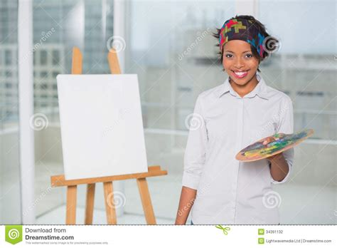 smiling artist holding palette stock photography image