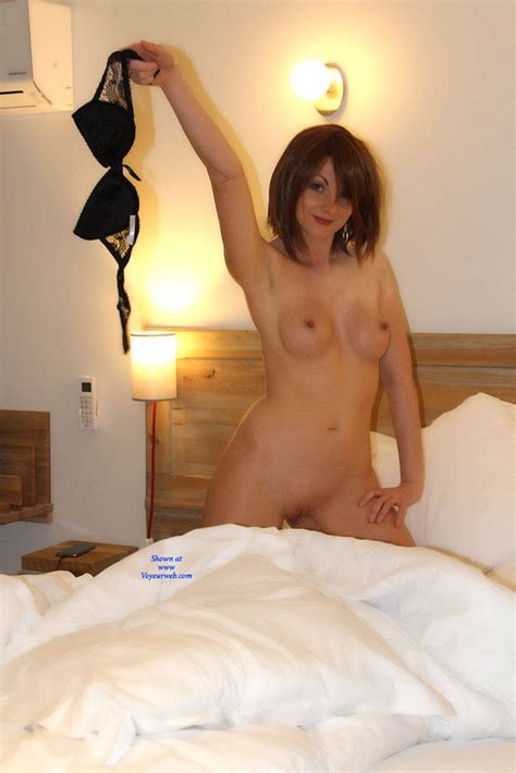 Sexy Brunette Stripping On Bed May Voyeur Web