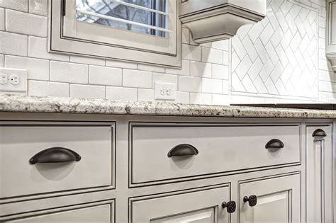 White Cabinets Bronze Hardware by White Cabinets With Glaze Rubbed Bronze Hardware