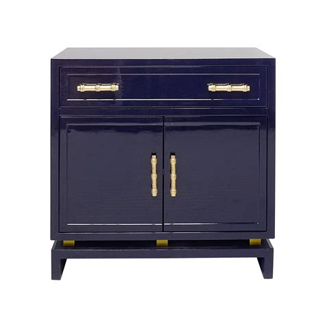 Its rustic wood surface is perfect to display your coffee table books and hold your beverages. Marcus Navy Lacquer & Gold Leaf Bedside Table   SHOP NOW