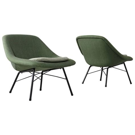pair of reupholstered mid century easy chairs for sale at