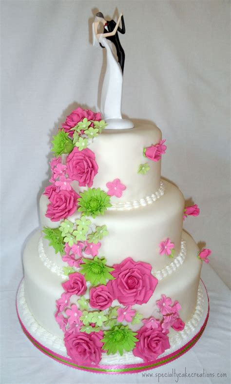 hot pink  lime green cascading flowers wedding cake
