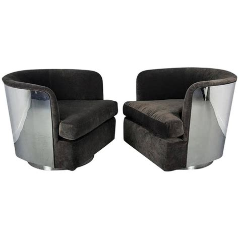 milo baughman chrome clad swivel lounge chairs for thayer
