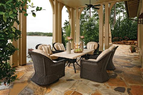 euro height outdoor wicker chairs  stone patio table