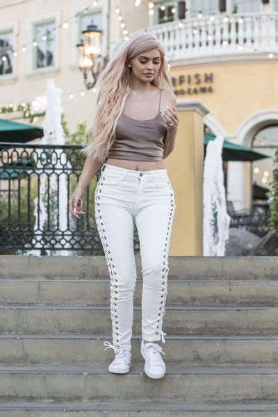kylie jenner wears  rose gold top  lace  pants
