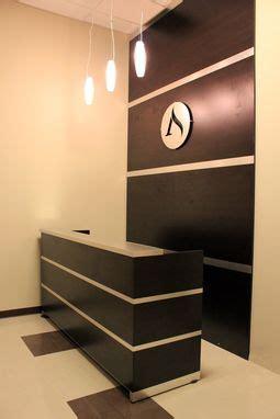 custom reception desk accent wall brushed aluminum