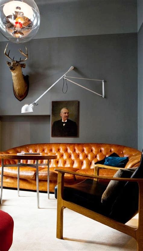 tan leather chesterfield  grey walls red orange