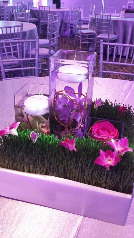 Adding Grass Around Your Centerpiece Adds A Pop Of Color