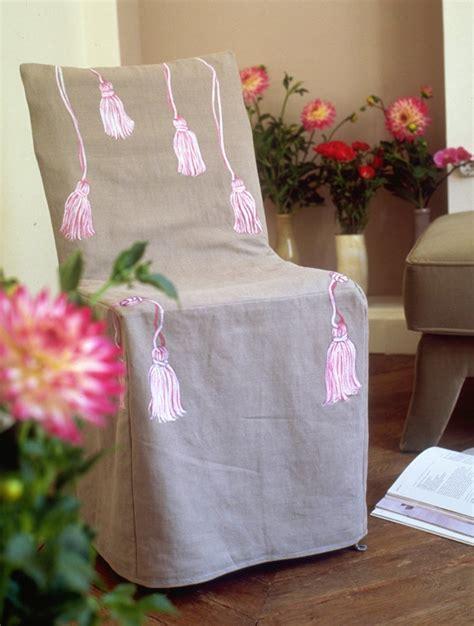 housse de chaise avec pompons peints