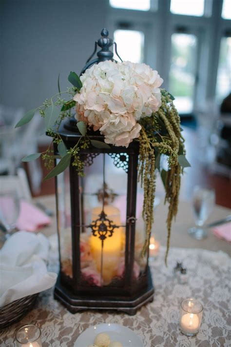 centerpieces with lanterns tall lantern centerpiece hobby lobby wedding pinterest