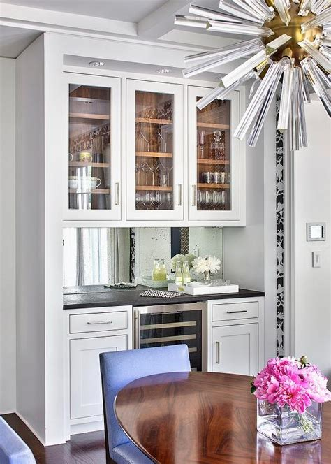 kitchen nook  bar cabinets  mirror backsplash