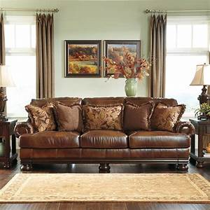 Signature designs by ashley 39hutcherson39 harness brown for Brown leather sectional sofa ashley furniture