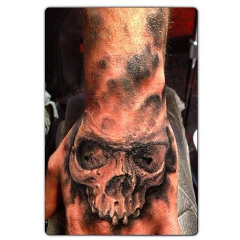 black  grey skull hand tattoo jamie hendersons tattoos pinterest skull hand tattoo