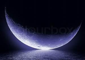 Half Of Moon In The Dark Blue Sky Over Water